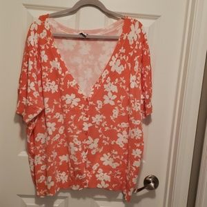 Orange and white floral short sleeved sweater